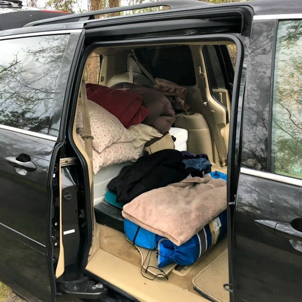 Minivan camper sleeping area.