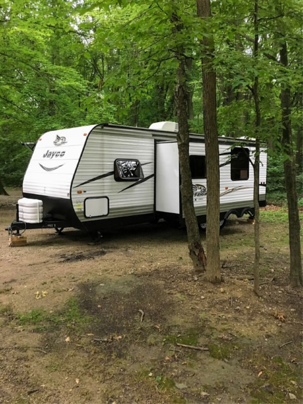 Camping in the trees of Chain O' Lakes State Park, Indiana.