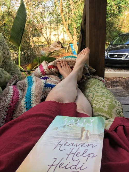 Enjoying a good book on the front porch at our Airbnb.