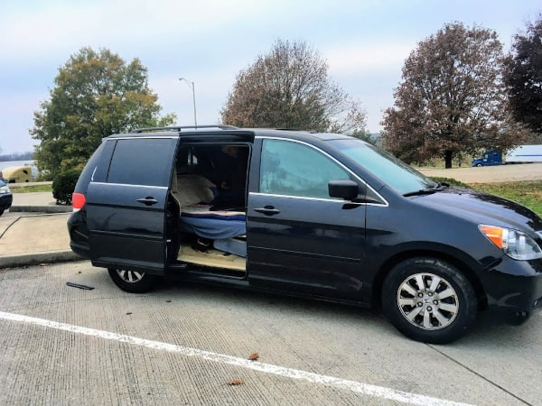 Our minivan camper parked in a rest area on the way to the Red River Gorge.